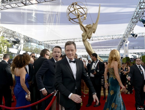 Mischief Managed: Breaking Bad's Aaron Paul Photo Bombs Brian Cranston On The Emmy Red Carpet