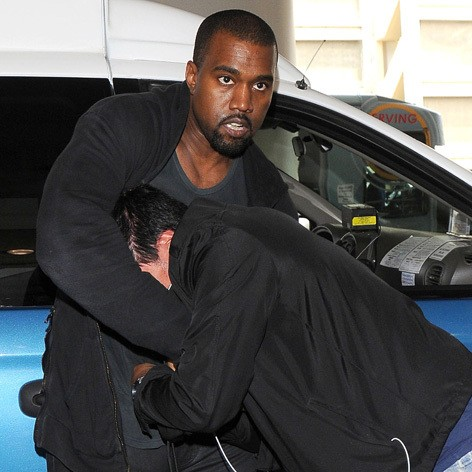 Kanye West Gets Physical With Another Paparazzo Outside His Home