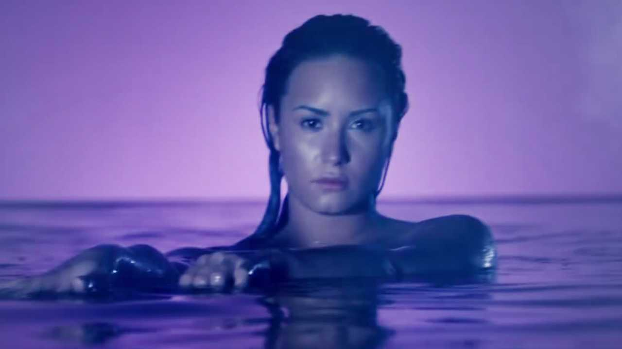 Demi Lovato Glows In Neon Lights Music Video