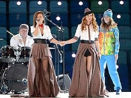 t.a.T.u Defies Russia's Anti-Gay Policies, Holds Hands During Opening Ceremony