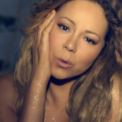 Mariah Carey Goes Topless For