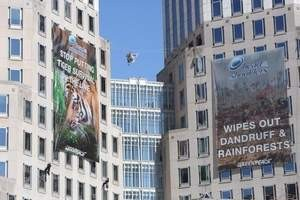 Greenpeace Protestors Rappel From Cincinnati's P&G Towers To Raise Awareness Of Deforestation