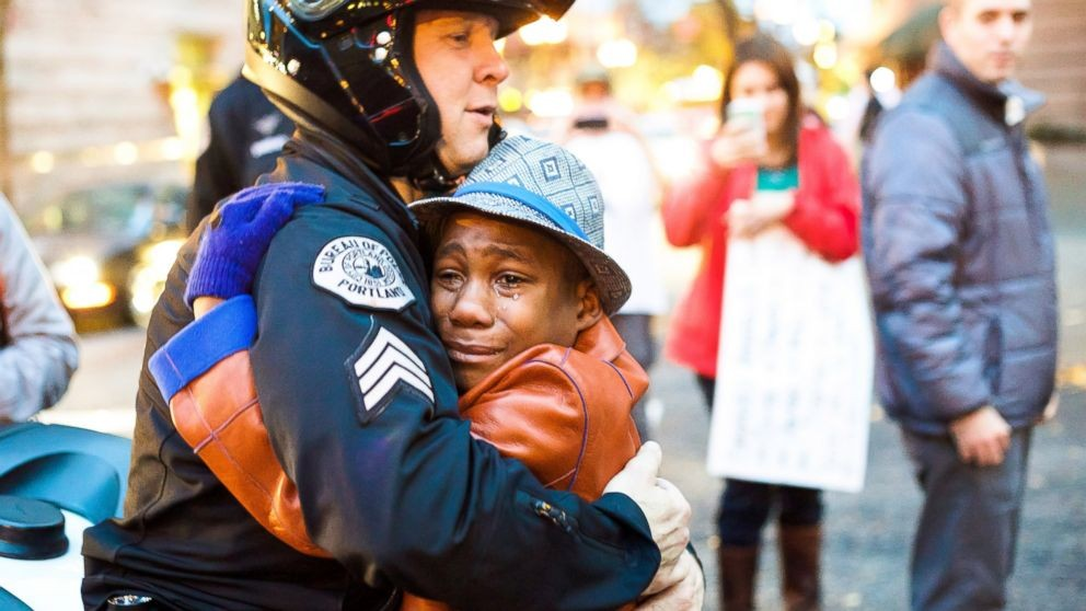 Police Officer And Protestor Share Hug During Ferguson Rally | ferguson