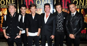 one-direction-this-is-us-premiere-simon-cowell-with-one-direction-1377024190-large-article-0